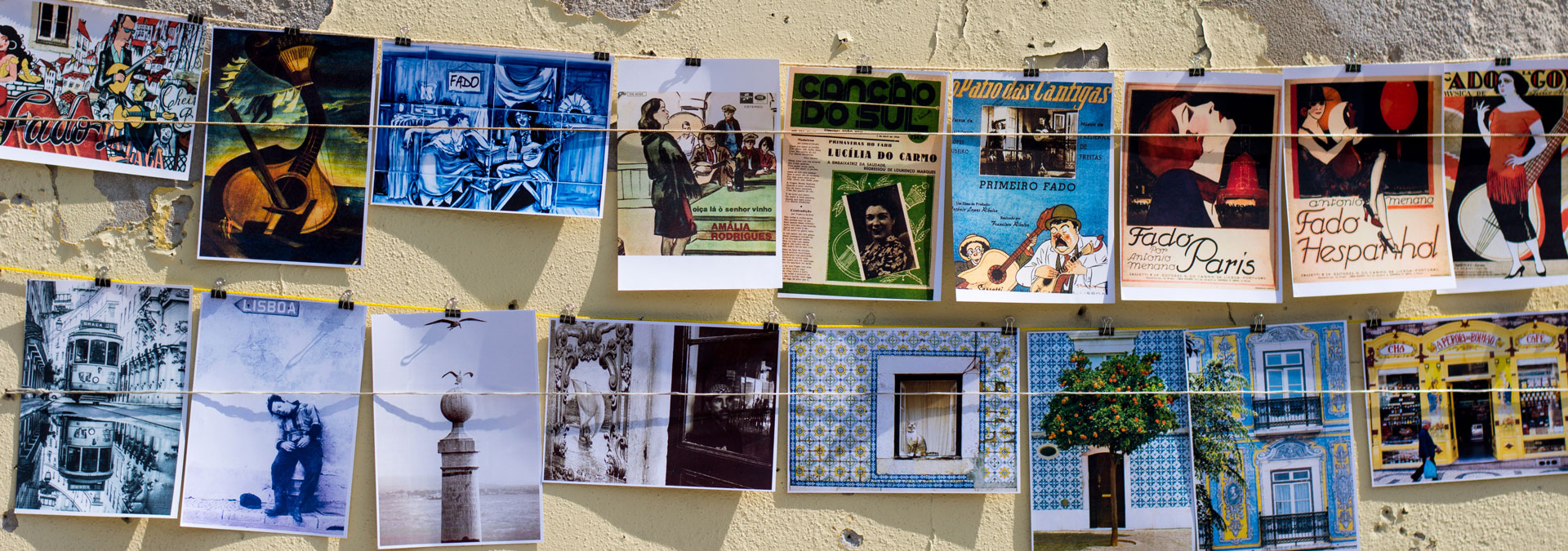 Colorful postcards hung from a wall